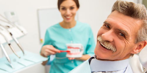 Smiling man dental checkup