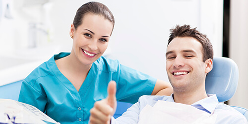 male patient doing thumbs up