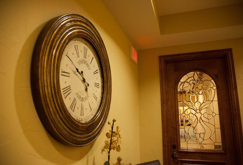 decorative clock by front entry