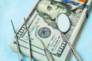 dental tools on money