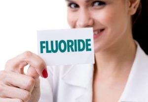 woman holding fluoride card