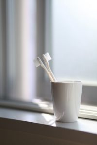 Toothbrush in cup as a dental office.