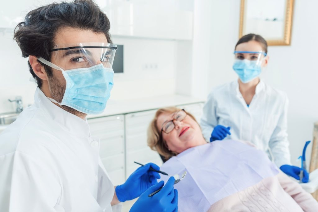 Dentist wearing face shield