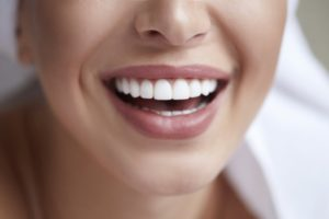 woman satisfied with teeth whitening in Plano