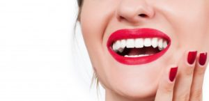 woman excited about cosmetic dentistry in Plano