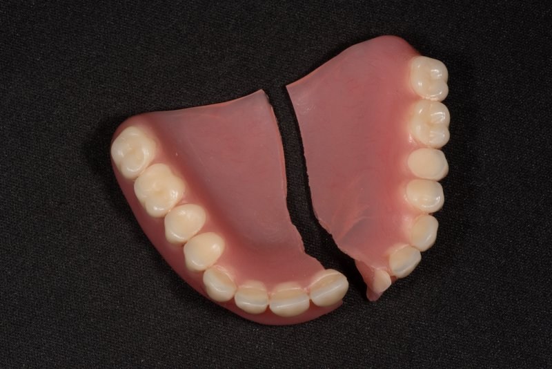 A broken denture resting on a table